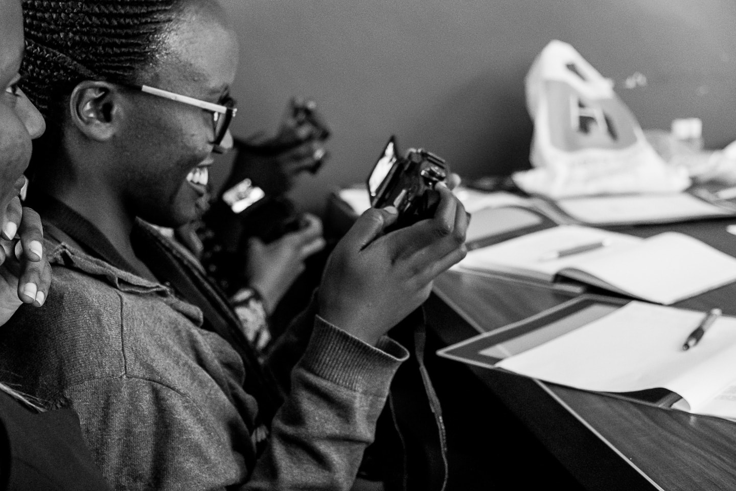 Prisca-studying-th-camera-functions-at-the-Cameras-For-Girls-workshop