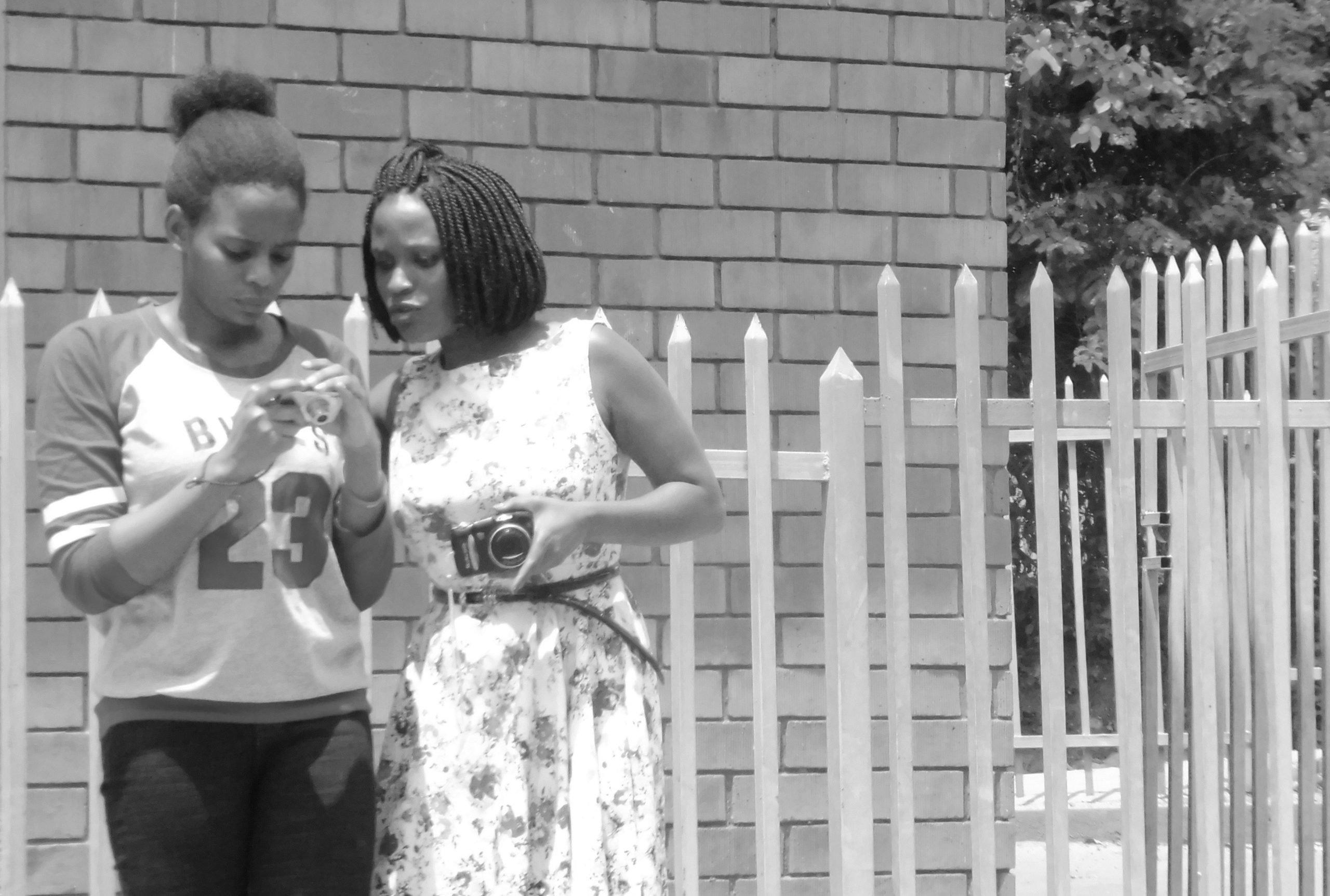 Sharon (on the right) practicing her photography with Lisa at the first Cameras For Girls training in 2018