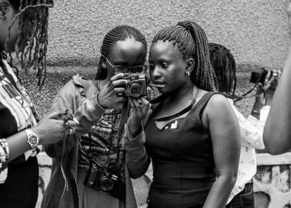 Prisca showing Lydia the photo she took in the Cameras For Girls training in Kampala, Uganda August 2019 @Amina Mohamed Photography