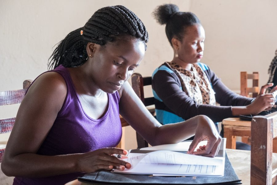 Sharon Kyatusiimire studying her training manual in the workshop, held in Kampala August 2018